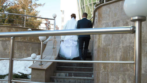 the bride and groom leave the ladder Live Action