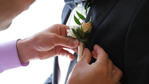 groom boutonniere help attach Footage