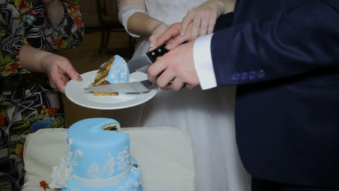 The Bride And Groom Cut The Wedding Cake stock footage