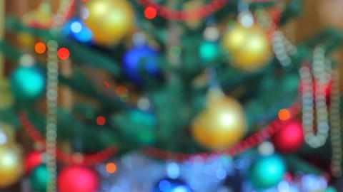 Christmas pine tree with lights defocused (New Year Tree) Footage