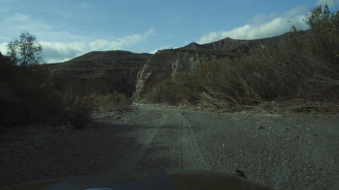 Offroad through a dry riverbed with a Jeep Wrangler, Andalusia, Spain Live Action