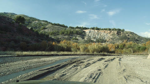 Offroad through a riverbed with a Jeep Wrangler, Andalusia, Spain Live Action
