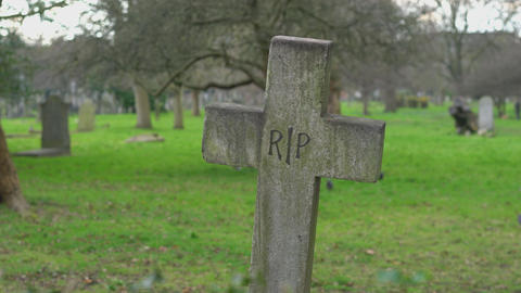 Old Rest in piece crucifix on a cemetery RIP Footage