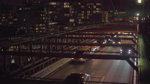 A lot of cars on the Brooklyn bridge by night Footage
