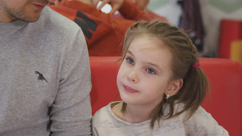 Family Has Dinner in Cafe Mother Feeds Daughter with Fork Footage