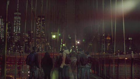 People walk on the Brooklyn bridge by night Footage