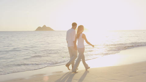 Honeymoon happy married young couple on beach Live Action