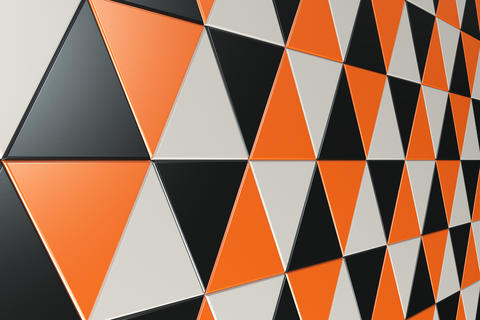 Pattern of black, white and orange triangle prisms Foto