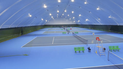 Aerial view of indoors tennis courts ビデオ