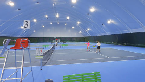 People plays tennis at indoors tennis courts Footage