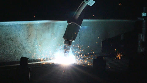 Timelapse of welding robot arm melt metal process at workshop. High Precision Footage