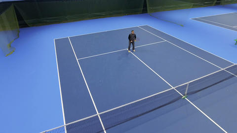 Handsome young man play tennis Footage