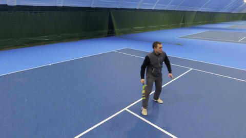 Man play tennis at tennis court Footage