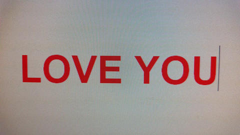 love you being typed on computer screen in close up 画像