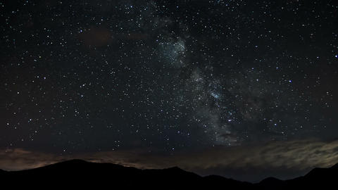 Stars moving in night sky over mountains time lapse. Milky way astronomy Footage