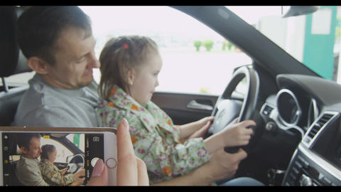 Mother Photos Child Sitting at Steering Wheel Slow Motion Archivo