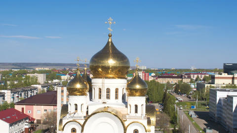 Orthodox Cathedral with Gold Domes against City Scape ビデオ