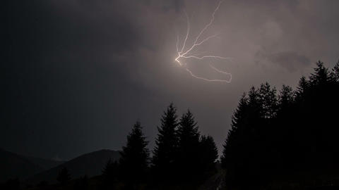 Storm at night with powerful lightning time lapse. Rain clouds. Two in one Footage