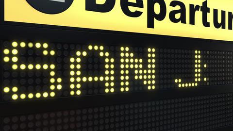 Flight to San Juan on international airport departures board. Travelling to Footage