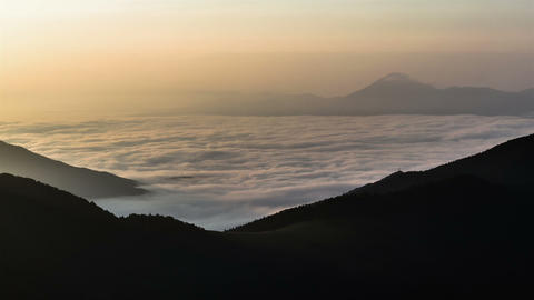 Foggy Morning above Clouds in Mountains Time Lapse. Sunrise Sea Waves of Mist Footage
