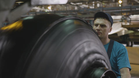 Worker Controls Tyre Assembling from Rubber Layers Footage