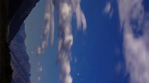 Vertical video. Moonlit night in the mountains. Time Lapse Footage