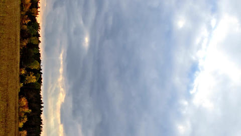 Vertical video. Rays of sun on a background autumn landscape. Time Lapse Footage