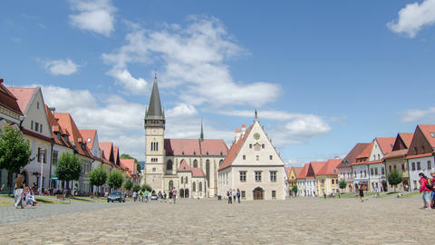 Time lapse of people and clouds in historic center of Bardejov in Slovakia. Zoom Footage