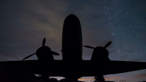 Stars sky turning over vintage military aircraft time lapse. Night sky with Live Action