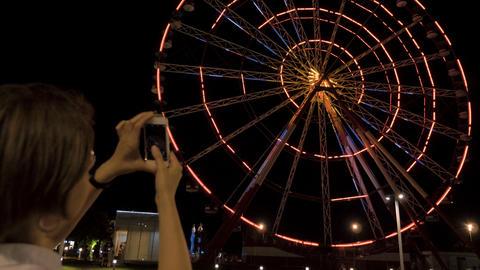 Ferris wheel at night in the city Batumi, Georgia Footage