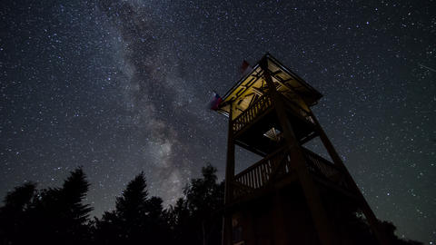 Stars sky with milky way turning over lookout tower time lapse. Astronomy starry Footage