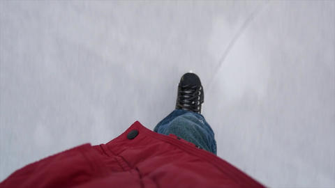 a man on an ice lake in ice skates is riding on ice, legs in iceskates Live Action