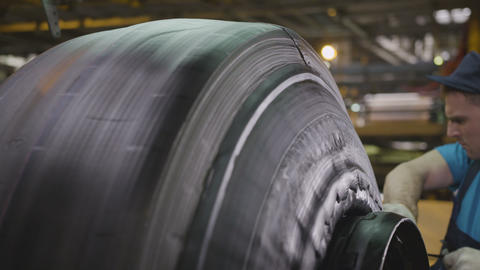 Machine Forms Tire from Rubber Layers and Worker Footage