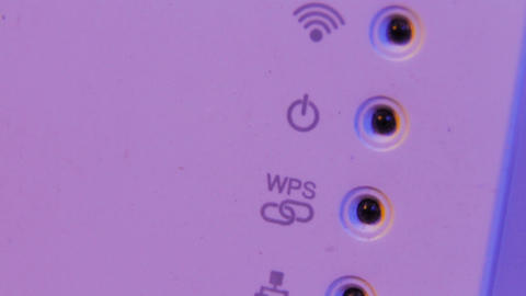 Closeup on WiFi repeater signal connection status led lights. The device is in Footage