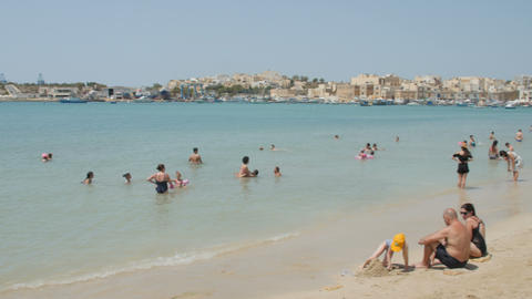 MARSAXLOKK, MALTA - July 6, 2016: Picturesque View With Water And People Leisure Footage