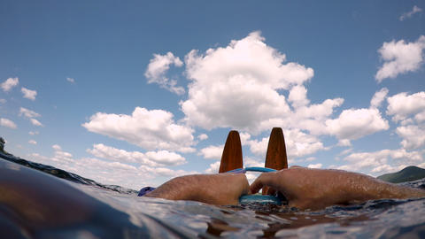 Underwater POV of a man getting ready to go water skiing in a lake gathering his Footage