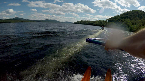 POV of a strong athletic man water skiing on a beautiful lake with vintage Footage