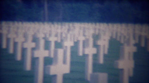 1963: White cross grave markers cemetery symmetrical row tombstones Footage