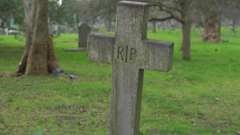 Old Rest In Piece Crucifix On A Cemetery RIP stock footage