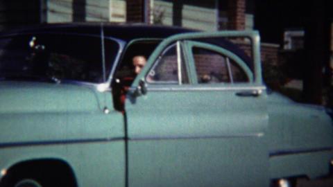 1954: Italian American women drives classic teal Oldsmobile car Footage