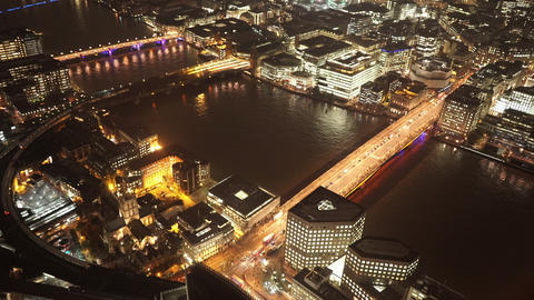 Fantastic aerial shot of London Bridges by night - LONDON, ENGLAND Live Action