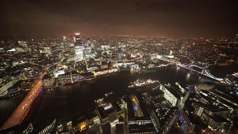 London Bridge and Tower Bridge by night aerial shot - LONDON, ENGLAND Live Action