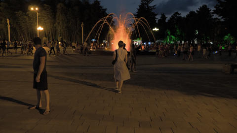 Pretty girl walking in the park of resort. Batumi city, Georgia Footage