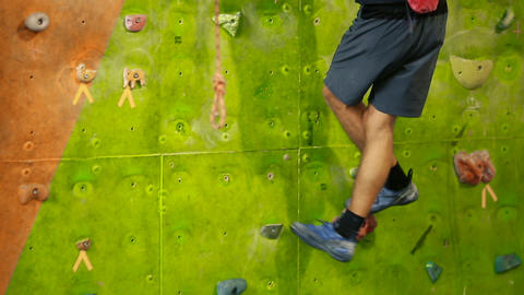 Legs of a professional rock climber closeup moving from one clue to another Footage