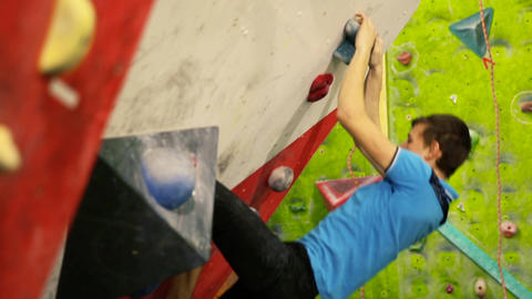 The climber is training to climb a mountain in the room. Close-up Footage