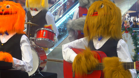 a group of musicians in the form of large soft toys, play various musical Footage
