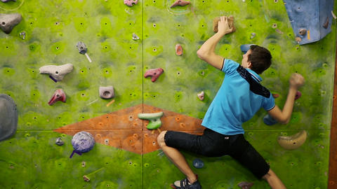 Climber indoor training overcomes the wall in the gym room Footage