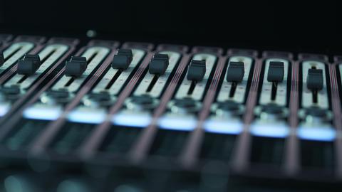 Soundboard knobs. Creating a sound design. DJ Workplace. sound engineer works Footage