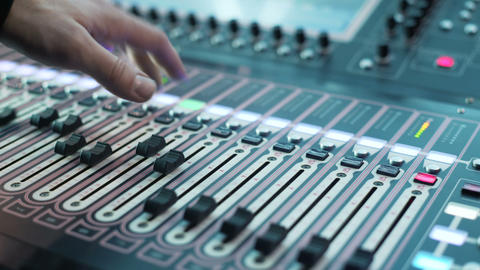 Recording studios audio console and knob. Sound producer records a musician Footage