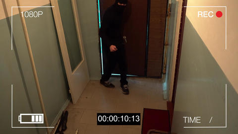 the masked robber burst through the door and broke the security camera with a Footage